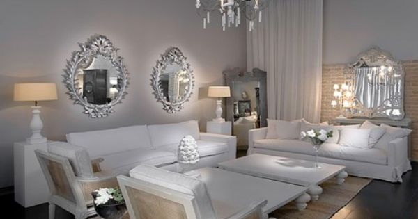 Glamorous white living room. Love all the ornate mirrors to add sparkle