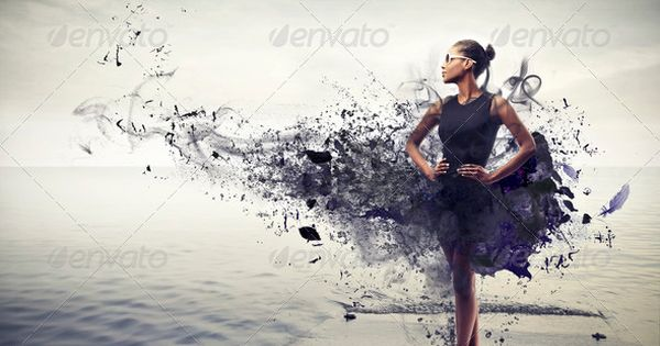 Black girl with a black dress that becomes black paint on a pier