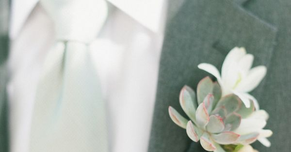 gray suit with a succulent boutonniere