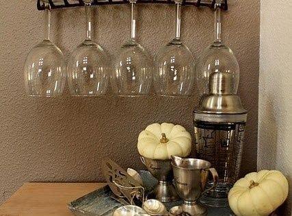 Old rake as a wine glass holder. cute idea