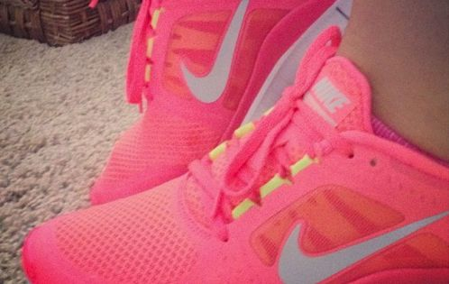 Neon Pink Nike Free Run Shoes.