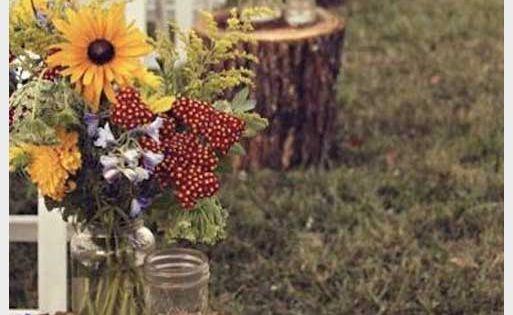 Wedding Ideas: Rustic - Flower filled Mason jars on tree stumps. Love love