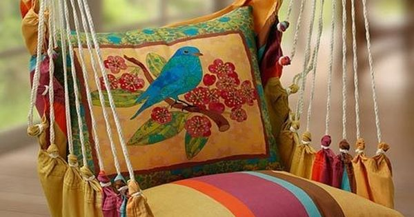 Love this suspended porch swing chair. So colorful!