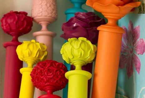 Spray paint curtain rods with bright colors! Especially adorable with white curtains!