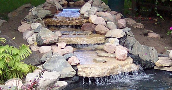 Wonderful website with great photos for constructing a for Prefab waterfalls for ponds