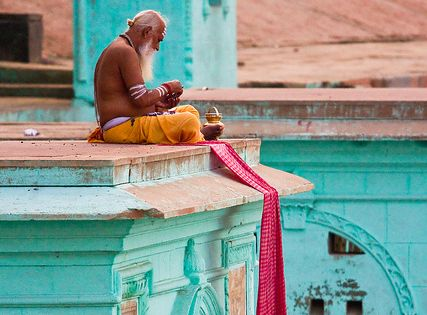 Sadhu morning prayer ritual, Varanasi, India by Ramnath Siva