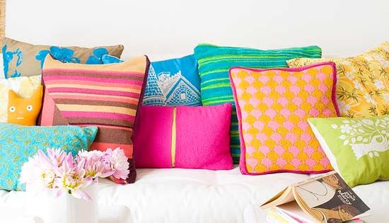 Throw pillows provide bursts of color in a mostly white space.