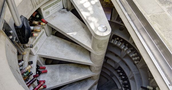 This Hidden Spiral Staircase Wine Cellar Is Incredible