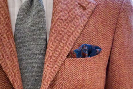 Grey tie, white shirt, pocket square, and red herringbone blazer. Unique fall