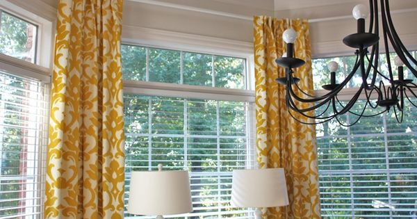 Hanging curtains in a bay window - curved curtain rod from Ikea