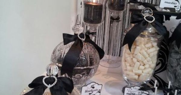 Elegant black & white themed party. I really like the bow decorations