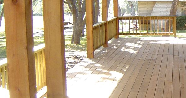 Covered Deck With New Wood Flooring Adds A Comfortable