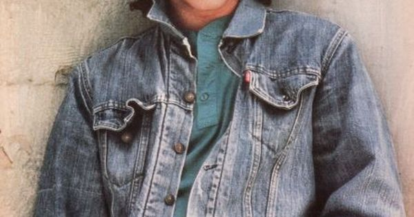 John Stamos, like the Jean Jacket and mullet.