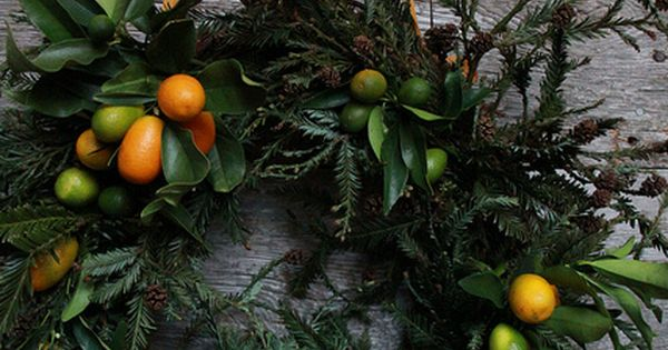 Fresh citrus kumquats for a cheery orange and green holiday wreath. 18