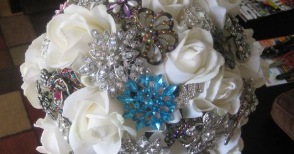 Brooch Bouquet: 30-40 brooches. 12 quality silk flowers. 2 bunches of silk