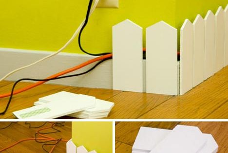 DIY picket fence to hide cords... cute idea