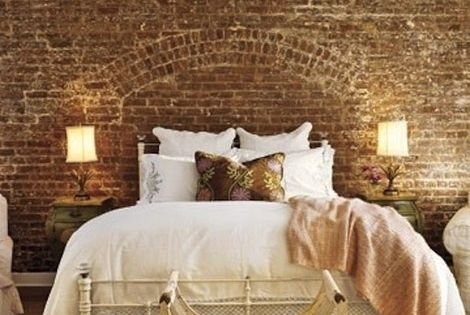 Have a exposed brick wall in your bedroom? Embrace and use it