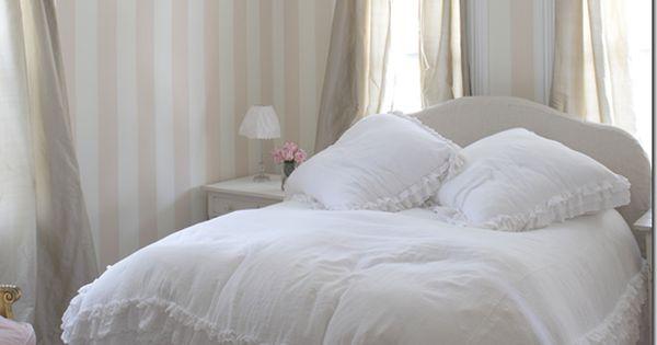 white bedroom, ruffly bedspread, striped walls
