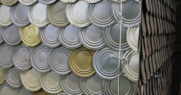 tin can lids as shingles on chicken coop great idea for a
