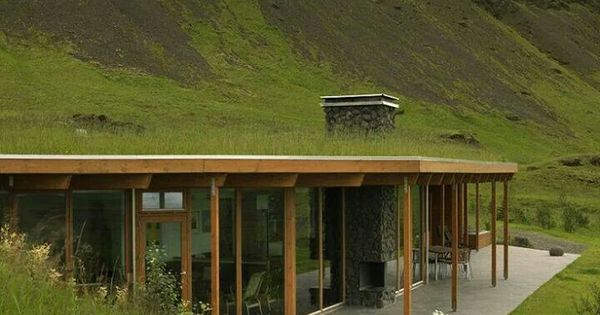 half-burried/underground house with green grass roof and ...