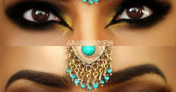 This eye makeup uses dark and teal eye shadow, accentuated by heavy