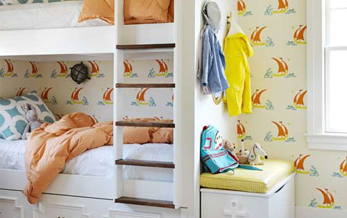 Playful wallpaper and cool bunk beds.