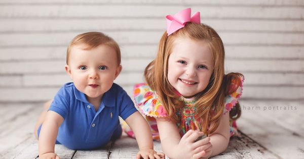 siblings in easter outfits in portrait studio