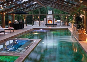 Outdoor Living Spaces Anderson Poolworks Indoor Outdoor Pool Pool Construction Green Pool
