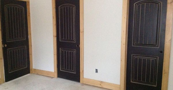 Black distressed doors with natural wood frame trim in for Natural wood doors interior