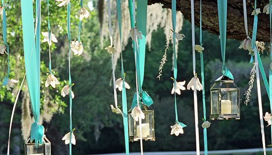 ribbon, flowers and lanterns hanging from tree