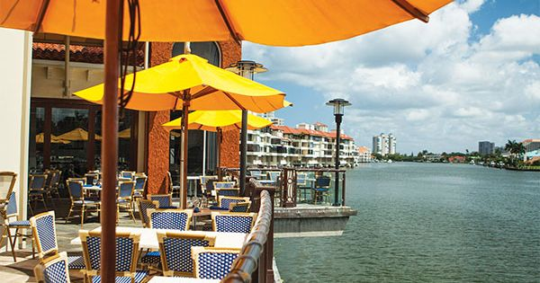 Dine on venetian bay on the patio at fish restaurant for Fish restaurant naples