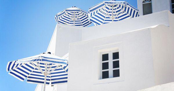 blue skies, striped umbrellas.