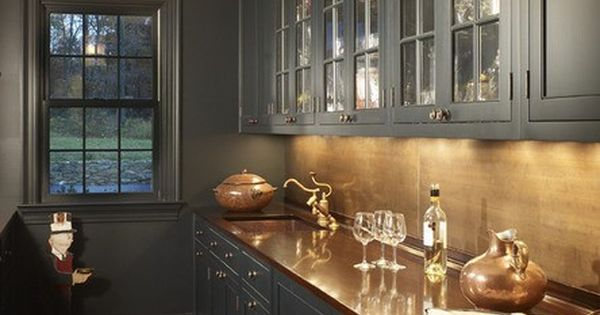 dark cabinets and copper countertop
