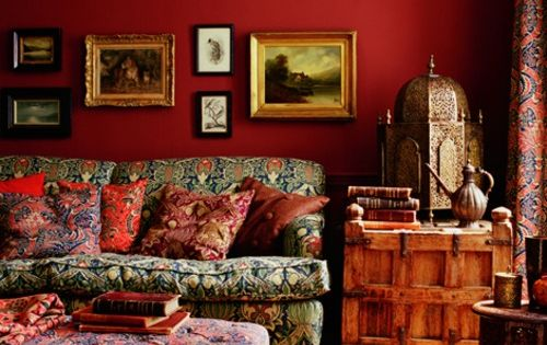 This bohemian living room sets funky fabrics and a fancy bird cage