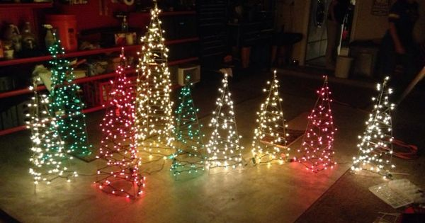Christmas Yard Decor. Trees made out of tomato cages and mini lights. Christmas homemade ...