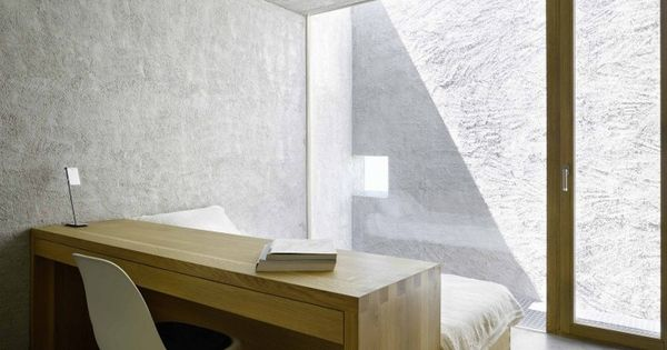 Bedroom inside the New House in Ranzo by Swiss architects Wespi de