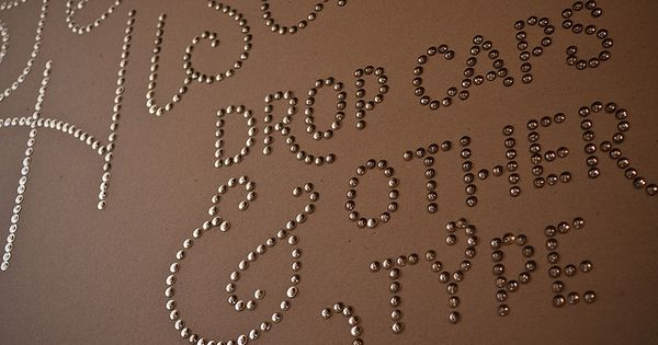 COOL Idea with Thumb tacks. Create your own wall words!