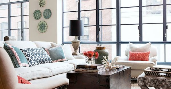 Chic city living room with ivory sofa & chairs, colorful throw pillows,