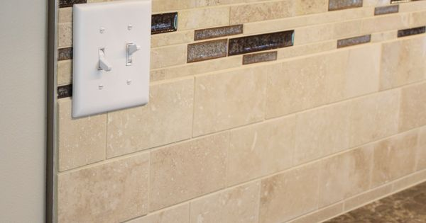 Schluter Strip Caps Off A Travertine Tile Backsplash In