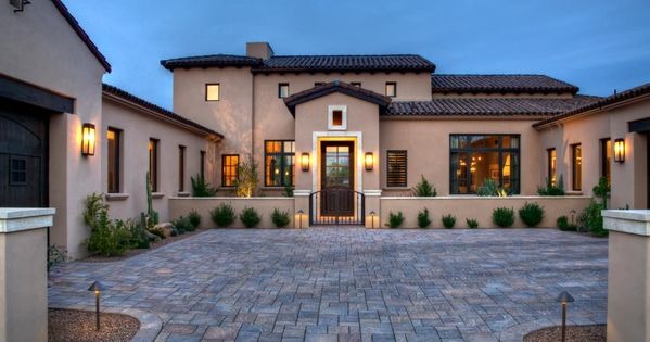 This serene mediterranean home features a neutral stucco for Mediterranean architecture features