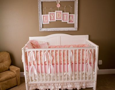 Chandeliers add such a nice touch to baby girls nursery.