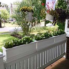 White Flower Boxes Sit On Top Of Porch Railings Porch Flowers Railing Planters Front Porch Flowers