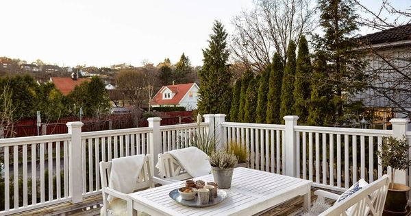Balcony Deck White Wooden Balustrade White Wooden Table And Benches