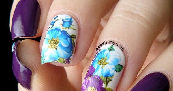 What a fabulous purple floral water decals manicure by @polish.my.nail Do you
