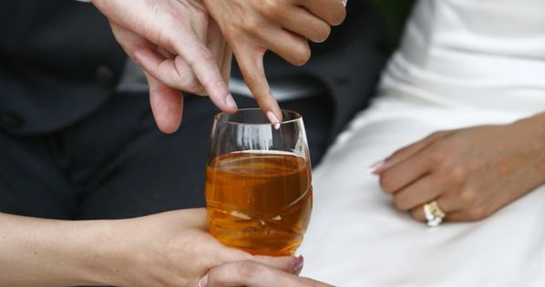 Honey dipped pinkies during wedding ceremony.