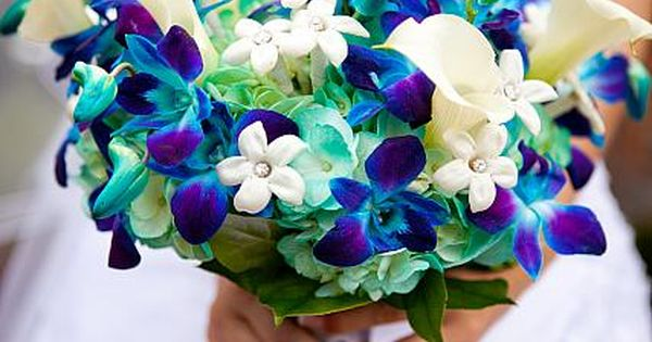Electric blue orchids with stephanotis and calla lillies