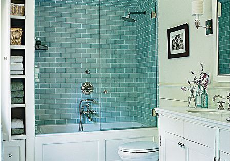pretty blue glass tile in shower and clever storage bathroom decorating bathroom