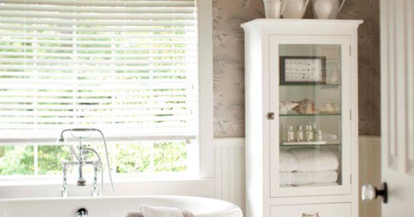 Great bathroom cabinet and bathtub.