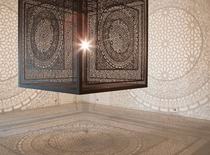 Intersections: An Ornately Carved Wood Cube Projects Shadows onto Gallery Walls Created