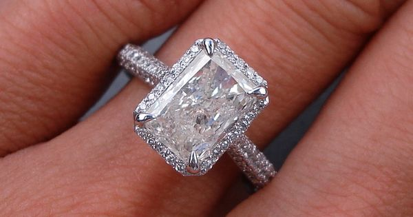 Radiant cut diamond engagement ring with a petite diamond halo and diamond